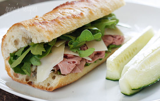Roast beef arugula and shaved parmesan on a baguette